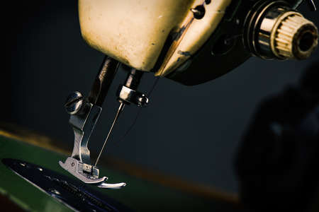 sartorial: Old Sewing Machine - macro photo background - industry