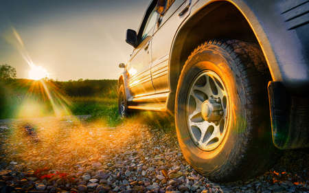 Off-road travel on mountain road. Beautiful mountains sunset Stock Photo