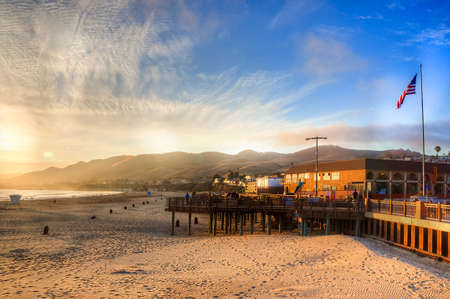 sun setting on Pismo beach pier - USA Stock Photo