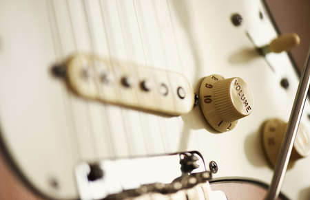 detail of electric guitar - volume control focused