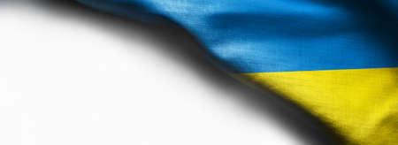 Waving flag of Ukraine on white background - right top corner flag Standard-Bild - 104807836