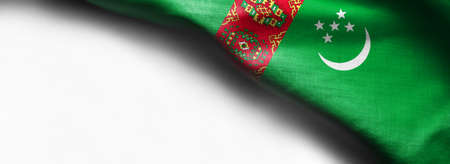 The flag of Turkmenistan on white background - right top corner flag