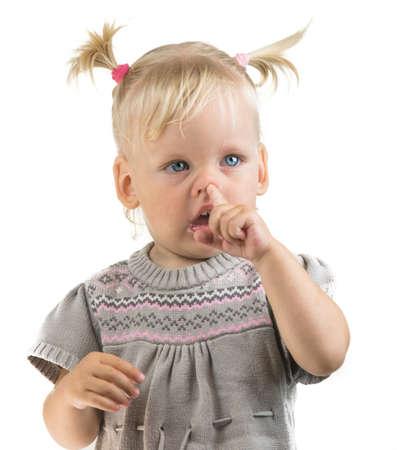 baby picking nose child portrait Standard-Bild - 105810312