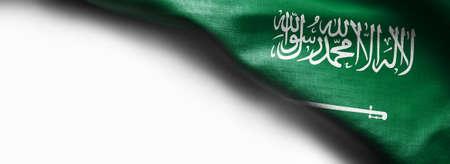 Bandera de textura de tela de Arabia Saudita sobre fondo blanco Foto de archivo