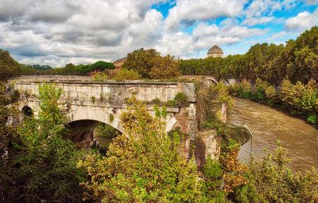 Rome cityscape - An old bridge in Rome Standard-Bild - 115454836