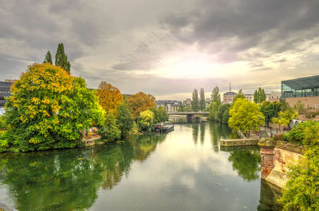 Cityscape of Strasbourg at sunset and Ill river in october, France