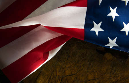 American flag on a dark wood background with space for text Stock Photo