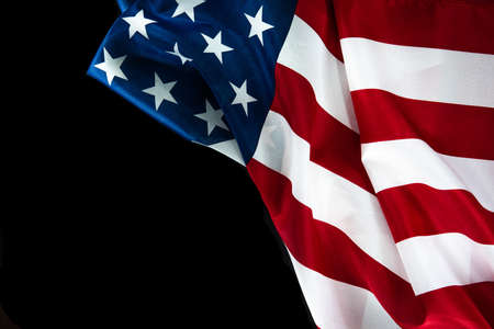 American flag on a black background with space for text