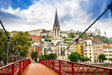 Pedestrian Saint Georges footbridge and the Saint Georges church in Lyon, France