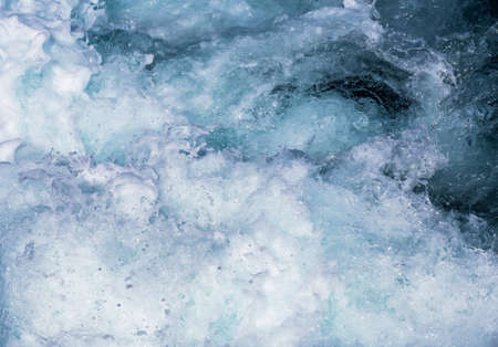 seething: seething blue deep sea water with white foam and bubbles Stock Photo