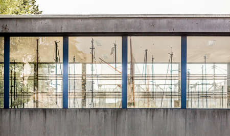 masts: Reflection in windows of bridge masts yachts. Four windows which shows ships. Stock Photo