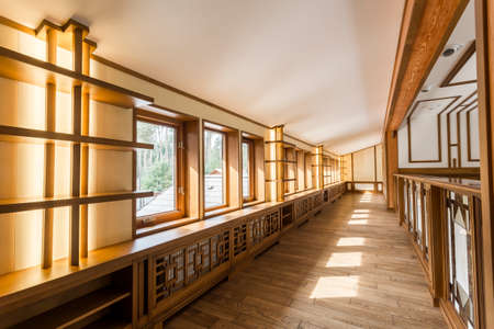 Interior corridor with hardwood walls and windows in empty house. Home design modern new and beautiful. Wood on the walls light brown. 版權商用圖片