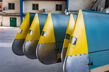 hangar: Helicopter blade close up taken from aircraft stand in the aviation hangar. Blades green and yellow. Stock Photo