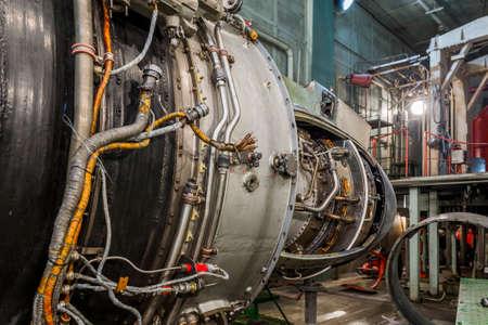 Turboshaft engine in aviation hangar. Turboshaft engine in aviation hangar. Archivio Fotografico
