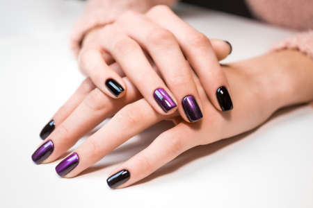 polish: Hand on hand with nice manicure. Shellac complete Manicure process in salon nail salon.