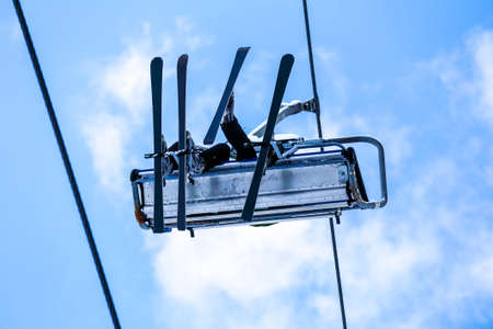 chair on the lift: Bottom view of skiers have a fun on chair lift in the sky