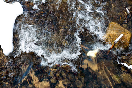 seething: top view of mountain river seething thru the stones