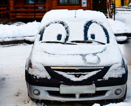 big smile: Car with eyes and big smile painted on snow