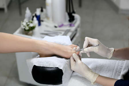 cuticle: Remove the cuticle in a beauty salon, on the background of the equipment