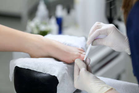 qualitative: Master pedicure doing qualitative service. professional approach to the service sector.