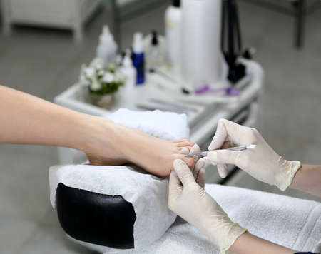 cuticle: Cuticle removing in a beauty salon, on the background of the equipment Stock Photo