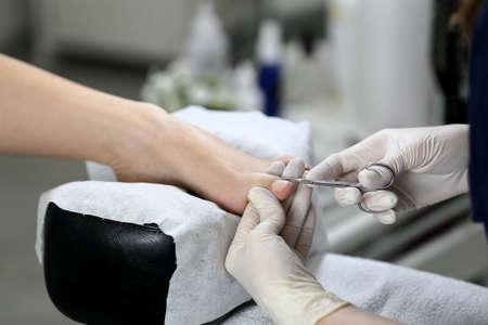 nail scissors: Cutting cuticle on foot, nail scissors. Pedicure process