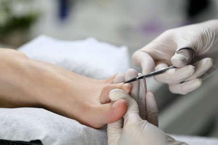 nail scissors: Close up Cutting cuticle on foot, nail scissors. Pedicure process