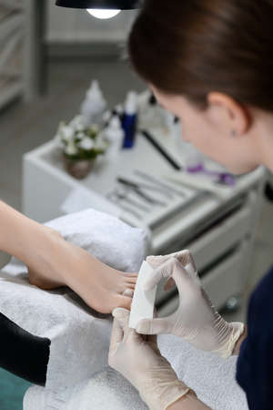 nails: Buff polishing nails in beauty salon pedicure Stock Photo