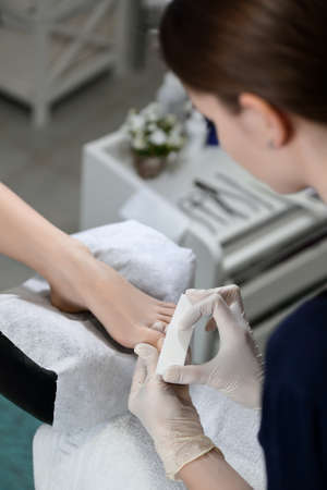 buff: Buff polishing nails in beauty salon pedicure with equipment Stock Photo
