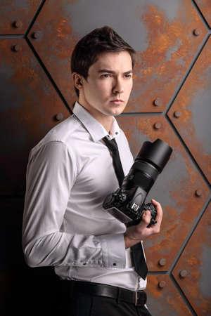 photo studio: studio photographer is posing to photo in studio