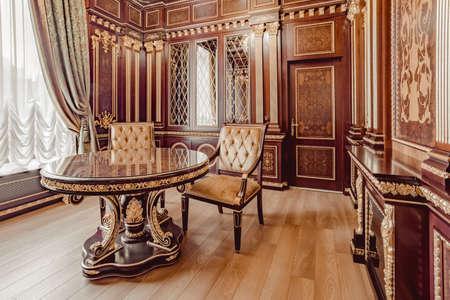 victorian fireplace: KIEV, UKRAINE - MAY 19, 2016: Interior photosession of the new demo conference room from Ukrainian furniture production. Rich style in wooden and gold textures from - Altair co.