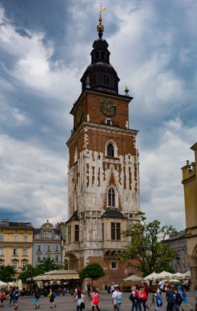 14th century: Krakow, Poland- May 25, 2016: Church of Our Lady Assumed into Heaven. Is a Brick Gothic church re-built in the 14th century. With tourists on square
