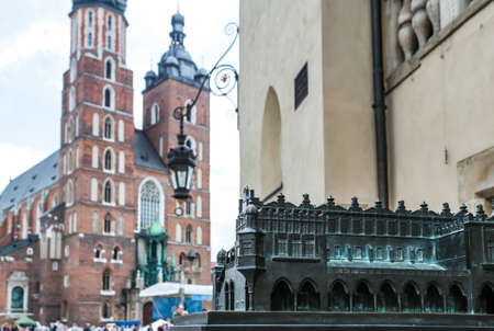 assumed: Krakow, Poland- May 25, 2016: Small copy of Church of Our Lady Assumed into Heaven. Is a Brick Gothic church re-built in the 14th century. With tourists on square