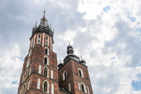 assumed: Krakow, Poland- May 25, 2016: Church of Our Lady Assumed into Heaven. Is a Brick Gothic church re-built in the 14th century. With tourists on square