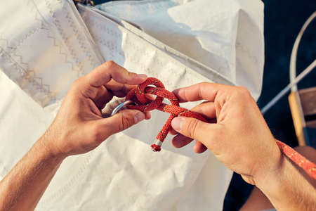 instruction sheet: User knitting knots. Bowline knot. Process of tying Bowline process is a top view on the sail.