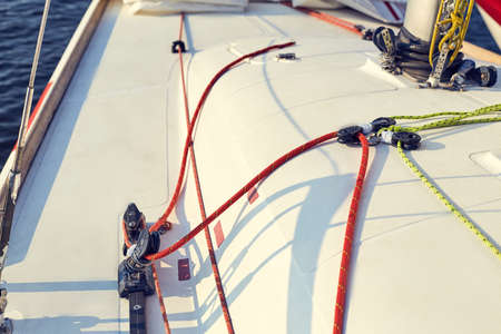 incorrect: Incorrect, tuning of control system staysail on sports yacht. Staysail sheet preparation Stock Photo