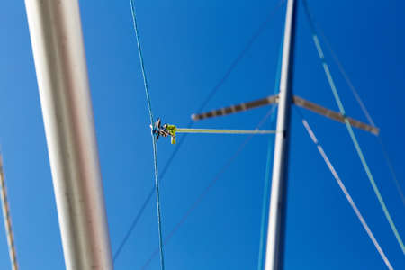 windward: The spinnaker pole is rigged to run from the base of the mast to windward over the side of the boat. Stock Photo