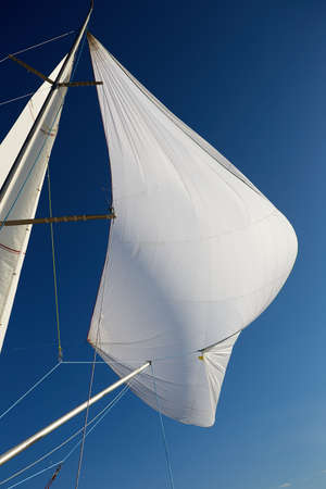 spinnaker: Flying the symmetric spinnaker on the yach in strong wind Stock Photo