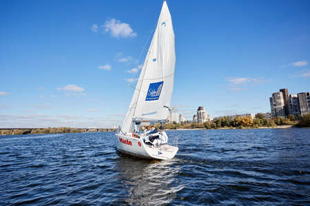 Kiev, Ukraine - September 30, 2016: Sailing yacht training day. Day before race on the Kiev reservoir or pond
