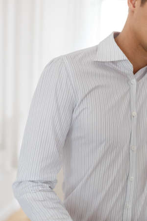 french cuffs: Half of a white shirt on businessman. Shirt on white background