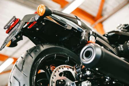 フロント バイク ディスク改とでタイヤをクローズ アップ。オートバイの新しい光沢のあるブレーキ ディスク 写真素材
