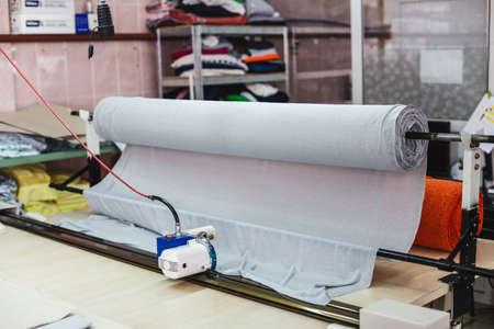 Machine for cutting a large fabrics. Machine cutter cutting cloth