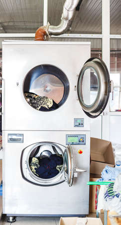 Cleaning services with industrial laundry washing machine with cloth.
