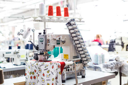 Fabric industry machinery production line. Industrial sewing machine close up.