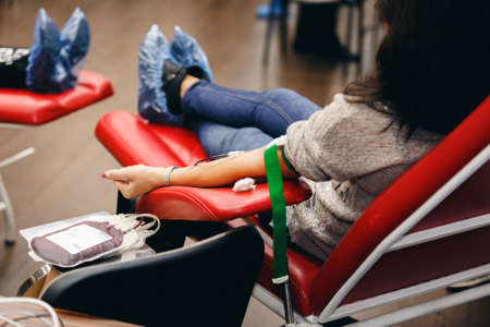 The donor blood donates blood in the clinic on a special chair. Blood sampling procedure for blood bank