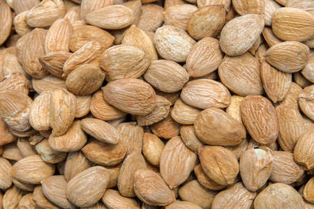 Background of the laid almond. Oriental treats. Background of nuts texture. Top view of the nuts. Stock Photo