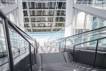 Stairs down in the hall with escalator