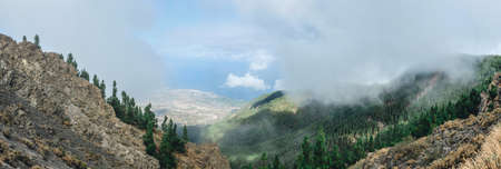 Perfect mountail lanscape in clouds of one island Stock Photo