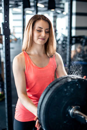 Girl adds weight to the bar with talc