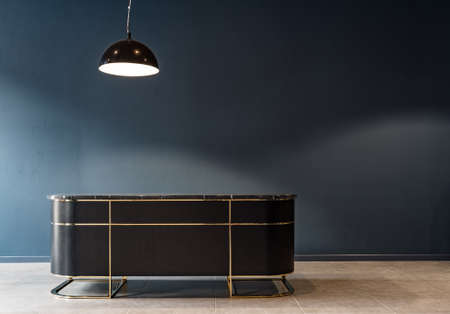 Business luxury table in the dark blue office with modern lamp